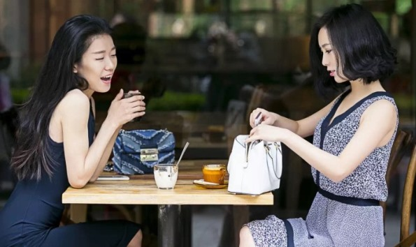 Cyber celebrities Ava Foo (l) and her business partner and fellow fashion blogger Nikki Min. Not content with serving as mere spokesmodels, Foo and Min have launched their own fashion line.